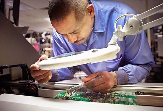 A Kohler quality technician inspects a KOHLER generator circuit board