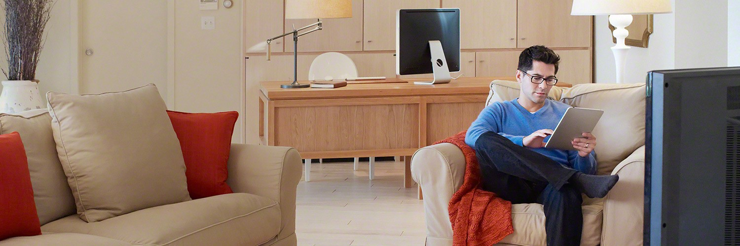 Man sitting in office with tablet