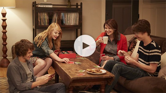 A single mom and her kids enjoy a special game night powered by a KOHLER generator
