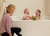 A young mom gives her kids a bubble bath powered by a KOHLER generator