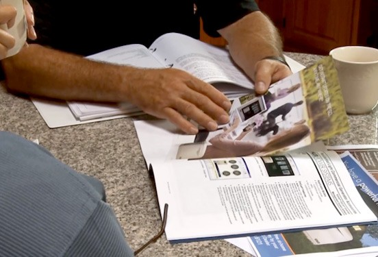 A Kohler dealer discusses details of a generator install with homeowners