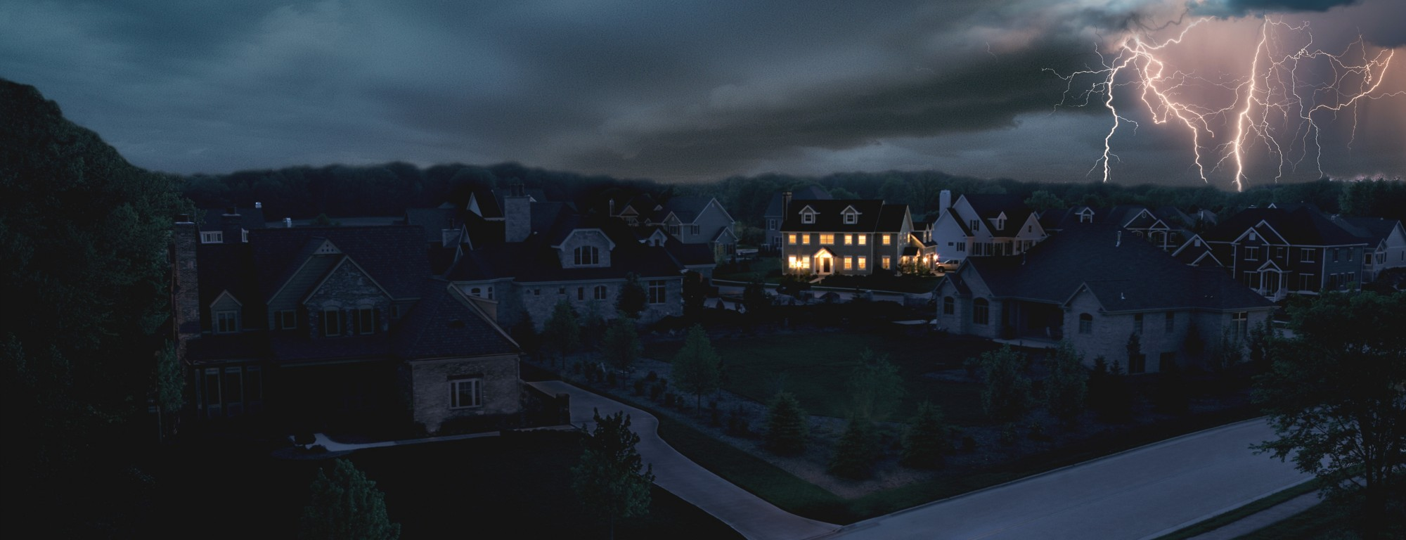 A single home is powered by a KOHLER generator in a neighborhood without power