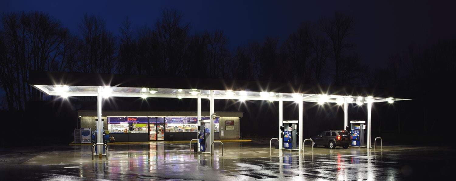A gas station is lit up against the night sky, powered by a KOHLER generator