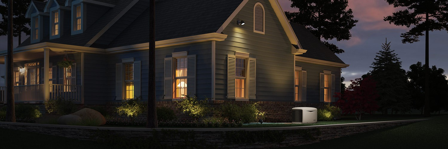 A beautiful home at dusk, full power featuring a KOHLER generator.