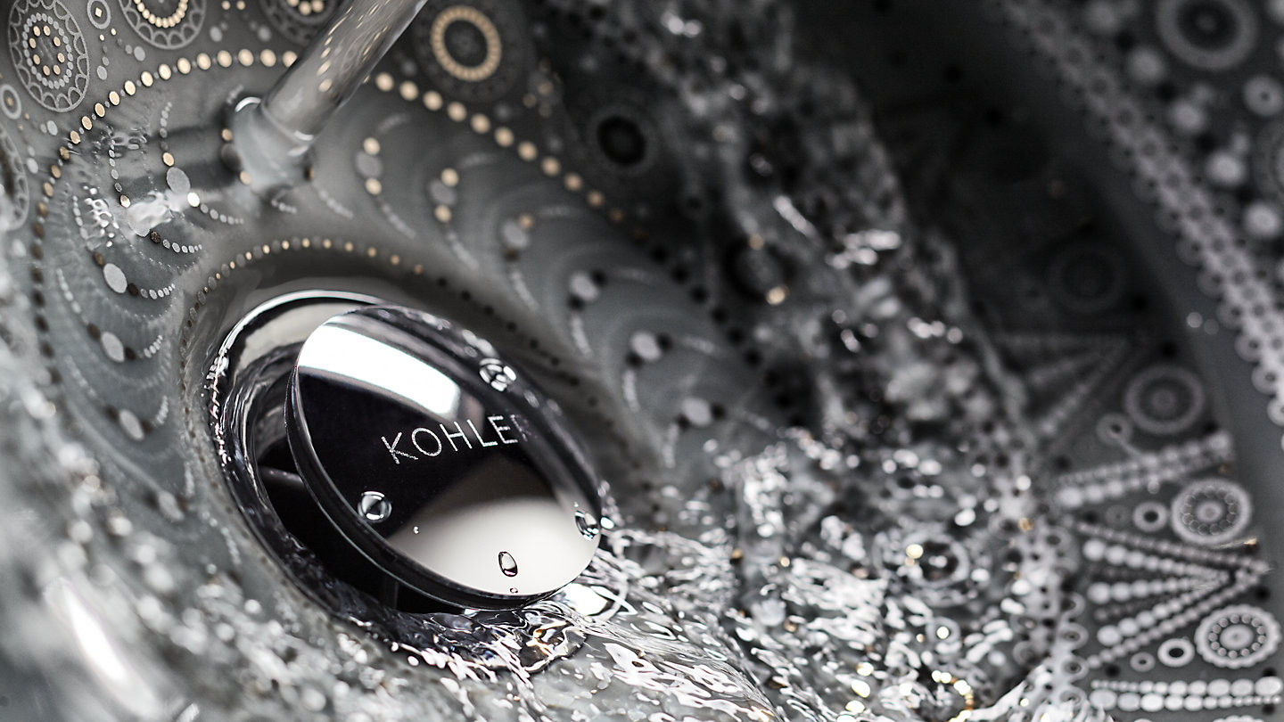 Water flows down the drain of a KOHLER Artist Edition sink.